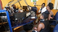 Malawi Capital Radio presenter Madalitso Phiri hosts a panel discussion with studio guests. Malawi media houses say implemention of the Access to Information Law will make news-gathering much easier. (Lameck Masina/VOA)