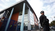 A policeman stands guard outside the custody center where a British police officer has been shot dead, in Croydon, south London, Britain, Sept. 25, 2020.