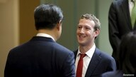 FILE - Facebook Chief Executive Mark Zuckerberg talks with Chinese President Xi Jinping during a gathering of CEOs and other executives at Microsoft's main campus in Redmond, Washington, Sept. 23, 2015.