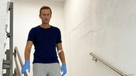 Russian opposition politician Alexei Navalny goes downstairs at Charite hospital in Berlin, Germany, in this undated image obtained from social media, Sept. 19, 2020.