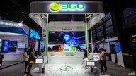 This photo taken on November 6, 2018 shows people visiting a booth of Qihoo 360 at the Light of Internet Expo ahead of the 5th…