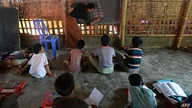 Rohingya refugee children study in a school at Kutupalong refugee camp, in Ukhia on October 5, 2020. (Photo by Munir Uz Zaman /…
