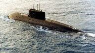 A Russian-built, Kilo-class diesel submarine recently purchased by Iran, is towed by a support vessel in this photograph taken…