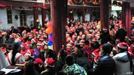 This photo taken on December 24, 2017 shows Chinese Christians attending a Christmas Eve mass at a church in Fuyang in China's…