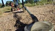 A deminer works near a metal detector at a testing area in a minefield during a demonstration to the media at the Demining…