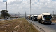 Trucks drive along the main road from the port city of Mombasa in the outskirtd of Kenya's capital Nairobi, March 4, 2016…