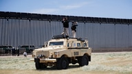U.S. Secret Service counter assault team (CAT) snipers stand atop a U.S. border patrol armored tactical vehicle.