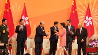 Hong Kong Chief Executive Carrie Lam toasts to Director of Safeguarding National Security of the central government.