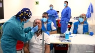 A man has a swab sample taken for a coronavirus disease (COVID-19) antigen test at a cultural centre in the working class…