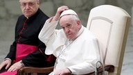 Pope Francis arrives at the Paul VI Hall for the weekly general audience, keeping a distance from faithful due to the…