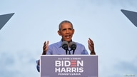 Former U.S. President Barack Obama gestures as he campaigns on behalf of Democratic presidential nominee Joe Biden.