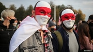 People attend an opposition rally to reject the Belarusian presidential election results in Minsk, Belarus October 25, 2020…