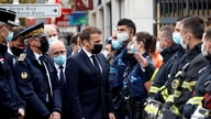 French President Emmanuel Macron visits the scene of a knife attack at Notre Dame church in Nice, France, Oct. 29, 2020.