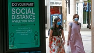 "Two women walk past a ""Social Distance"" sign at City Creek Center Wednesday, May 6, 2020, in Salt Lake City. City Creek Center…"