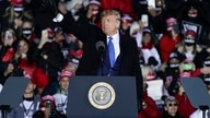 President Donald Trump waves after speaking at a campaign rally at the Waukesha County Airport, Oct. 24, 2020