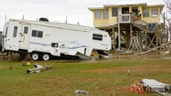 A camping trailer by a neighboring camp has been damaged by Hurricane Zeta in Grand Isle, La., Friday, Oct. 30, 2020.  Gov…