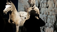 In a Tuesday, Dec. 12, 2017 photo, visitors look over some of the Terracotta Army soldiers on exhibit at the Virginia Museum of…