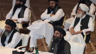 Taliban co-founder Mullah Abdul Ghani Baradar speaks, bottom right, talks at the opening session of the peace talks between the…