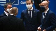 Luxembourg's PM Xavier Bettel, left, speaks with European Council President Charles Michel, right, and Greek PM Kyriakos Mitsotakis, center, during a round table meeting at an EU summit at the European Council building in Brussels, Oct. 1, 2020.