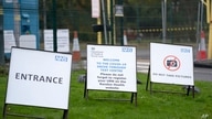 Signs outside a COVID-19 drive through test centre in Bidston, England, Monday Oct. 12, 2020. The British government is set to…