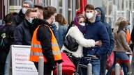 People wait in line for a COVID-19 test at a coronavirus test center in Cologne, Germany, Oct. 15, 2020.