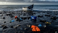 A wooden boat used by migrants from Morocco is seen at the coast of the Canary Island on Friday, Oct.16, 2020. Migrants and…