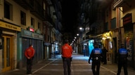 Polices officers patrol a street before closing all bars and restaurants at 10 p.m. due to the new measures to prevent the…