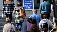 Residents line up outside the Montgomery County, Pa., Voter Services office, Monday, Oct. 19, 2020, in Norristown, Pa. Monday…