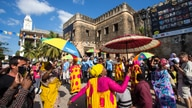 Festival parade on route at Sauti za Busara 2015 [photo Peter Bennett]