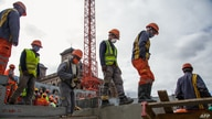 FILE - Workers are seen on a construction site of a concrete arena in Antananarivo, Madagascar, May 22, 2020.