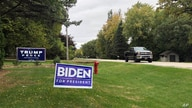 FILE - Signs for Democratic presidential candidate former Vice President Joe Biden and President Donald Trump mark neighboring properties in a middle-class neighborhood of Oshkosh, Wisconsin, Sept. 29, 2020.
