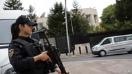 FILE - A special security force member stands guard near the U.S. Embassy in Ankara, Turkey, Oct. 8, 2019.