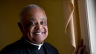 FILE - Washington D.C. Archbishop Wilton Gregory poses for a portrait following Mass at St. Augustine Church in Washington, June 2, 2019.