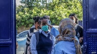 A student has her temperature measured before entering the school premises at the Ethio Parents elementary and high school in…