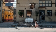 Children play in front of a hotel damaged by mortar shelling, in Humera, Ethiopia, on November 22, 2020. - Prime Minister Abiy…