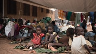 This photo taken on July 1, 2016 shows children resting as people wait to be registered as displaced persons in a South Sudan…