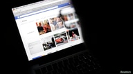 Vietnamese Internet activist Nguyen Lan Thang looks at a Facebook page at a cafe in Hanoi November 27, 2013.  Vietnam will hand…