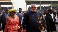 Ghana's former President Jerry Rawlings arrives for the the swearing-in of Ghana's new President Nana Akufo-Addo in Accra,…