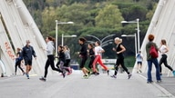 Women jog on Ponte della Musica during an exercise class, as the spread of the coronavirus disease (COVID-19) continues in Rome…