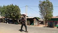 A member of the Amhara Special Force patrols a street in Soroka village in Amhara region near a border with Tigray, Ethiopia…