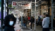People wait in line outside of a coronavirus disease (COVID-19) testing center in New York City