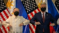 U.S. National Security Advisor Robert O'Brien and Philippines' Secretary of Foreign Affairs Teodoro Locsin Jr. elbow bump.