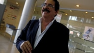 FILE PHOTO: Former Honduran President Manuel Zelaya smiles upon his arrival at Toncontin International Airport in Tegucigalpa,…