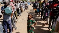 Ethiopian refugees wait in lines for a meal at the Um Rakuba refugee camp which houses Ethiopian refugees fleeing the fighting in the Tigray region, on the Sudan-Ethiopia border, Nov. 28, 2020.
