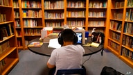 FILE - In this Aug. 26, 2020 file photo, a Los Angeles Unified School District student attends an online class at Boys & Girls…