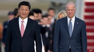 FILE - In this Sept. 24, 2015 file photo, Chinese President Xi Jinping and Vice President Joe Biden walk down the red carpet on…