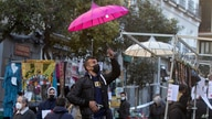 A stall-holder sets up his display in the Rastro flea market in Madrid, Spain, Sunday, Nov. 22, 2020. Madrid's ancient and…