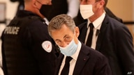 Former French President Nicolas Sarkozy arrives at the courtroom, Nov. 23, 2020 in Paris.