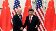 FILE - In this Dec. 4, 2013, file photo, Chinese President Xi Jinping, right, shakes hands with then U.S Vice President Joe Biden as they pose for photos at the Great Hall of the People in Beijing.