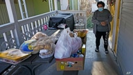 Evelyn Maysonet looks at the food delivery from the Weber-Morgan Health Department Tuesday, Nov. 24, 2020, in Ogden, Utah…